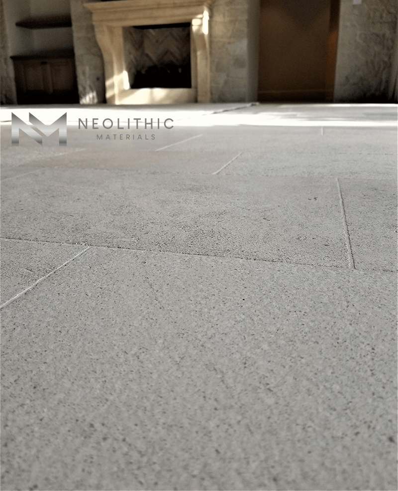 Close up view of Reclaimed Burgundy Limestone used in the flooring of a house