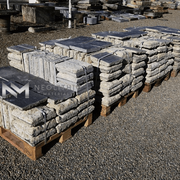 Pile stock of Antique Petit Granit used for flooring, walling and many more