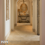 Classic Reclaimed Corsica Limestone used in flooring in the hallway of a house