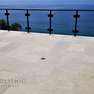 Close up look of High-Quality Dalle de Montresor Reclaimed Stone installed in terrace with a beautiful ocean view