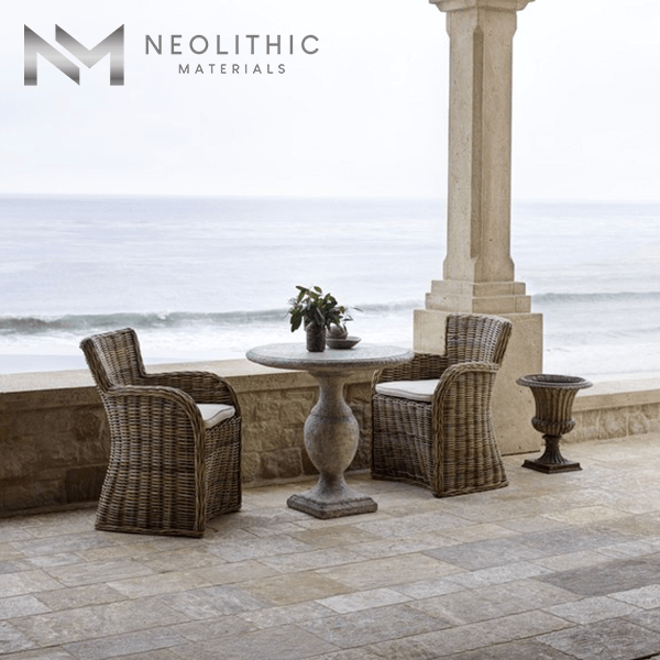 Antique Reclaimed Corsica Stone used in flooring of a classic balcony with a nice spot for ocean viewing