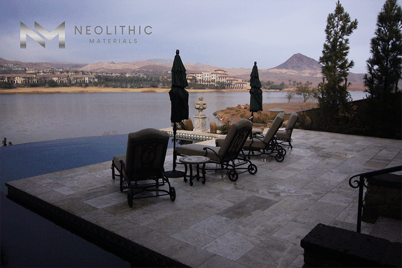 Maltese Limestone installed in a beautiful infinity pool with wide view of a lake
