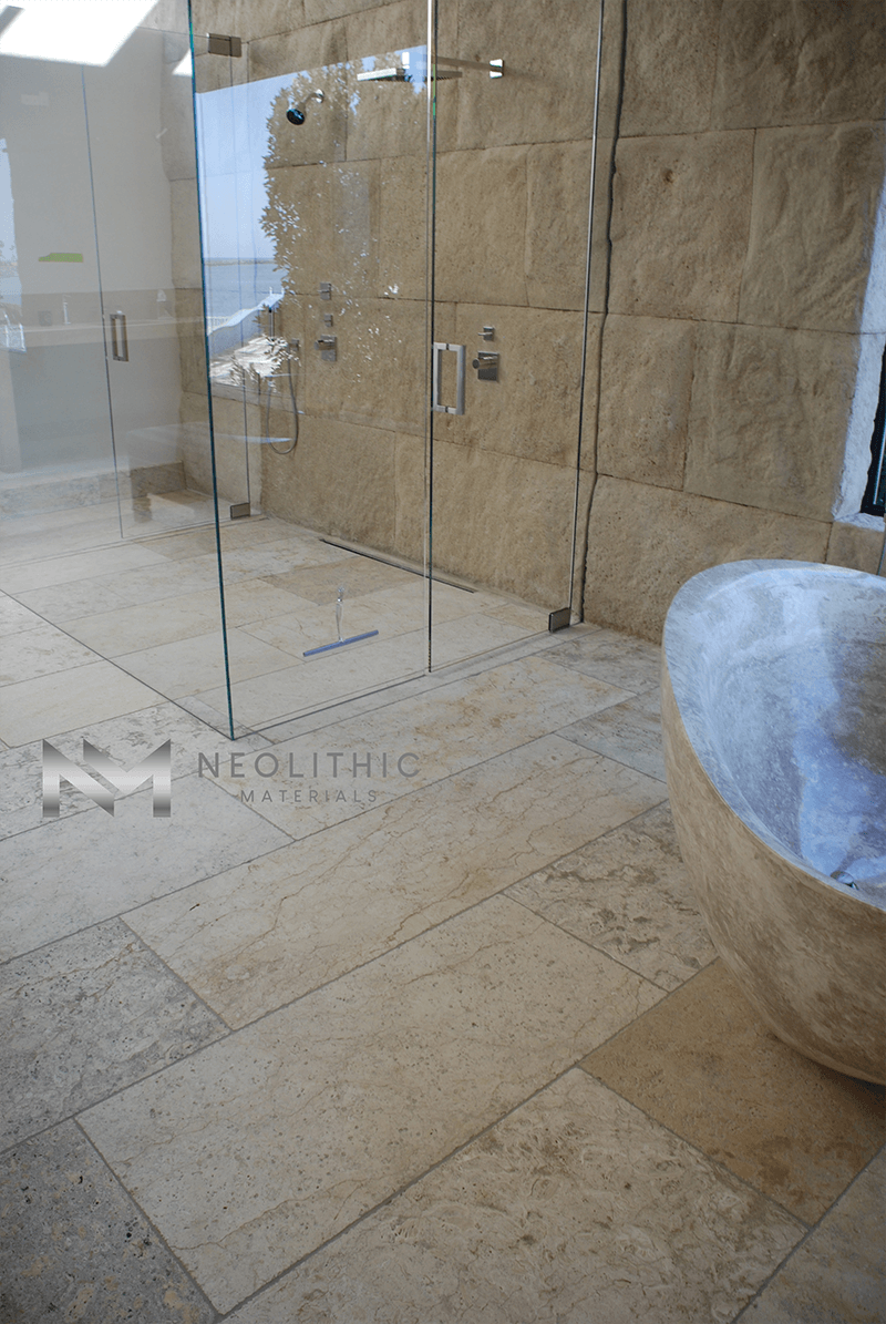Maltese Limestone Blocks installed in a wall of a classic yet modern equipment of a bathroom