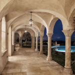 High Quality Maltese Limestone installed in the flooring, walling and columns of a classic house with a beautiful pool at the side