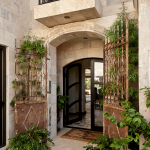 Reclaimed Maltese Limestone installed in a wall of a classic house