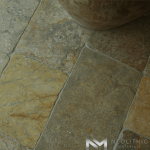 Close up view of Reclaimed Antediluvian Limestone used in flooring