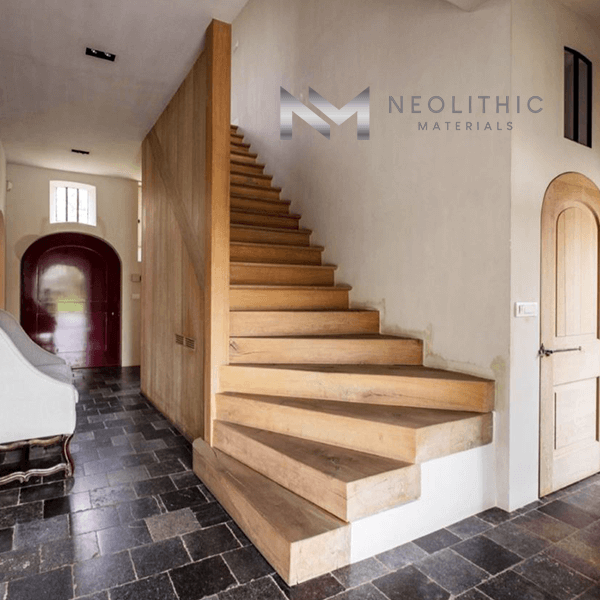 Reclaimed Belgium Bluestone used in flooring near the stairway of the house