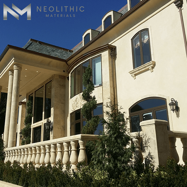 Front view of a house that has a reclaimed stone home balustrade