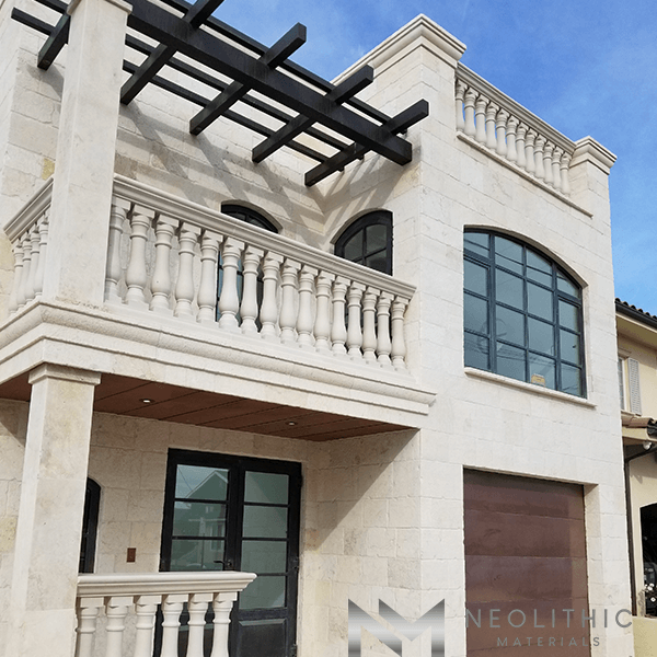 Front view of a house that has a reclaimed stone terrace balustrade