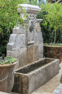 Reclaimed Wall Fountain outdoor, nestled to the corner in the garden.